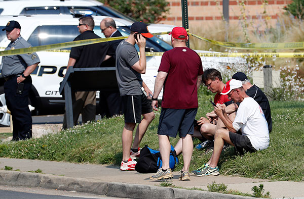 "<div class=""meta image-caption""><div class=""origin-logo origin-image none""><span>none</span></div><span class=""caption-text"">People gather near the scene of a shooting near a baseball field in Alexandria, Va., Wednesday, June 14, 2017. (Alex Brandon/AP Photo)</span></div>"