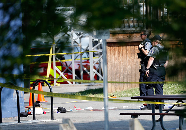 <div class='meta'><div class='origin-logo' data-origin='none'></div><span class='caption-text' data-credit='Alex Brandon/AP Photo'>Law enforcement officers stand at the scene of a shooting near a baseball field in Alexandria, Va., Wednesday, June 14, 2017.</span></div>