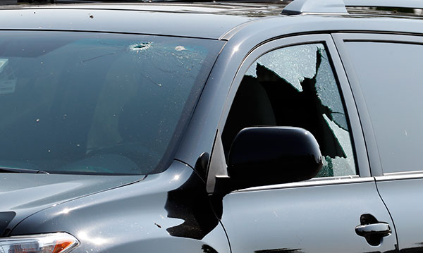 <div class='meta'><div class='origin-logo' data-origin='none'></div><span class='caption-text' data-credit='Alex Brandon/AP Photo'>A vehicle is seen with bullet holes in it at the scene of a shooting near a baseball field in Alexandria, Va., Wednesday, June 14, 2017.</span></div>