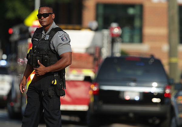 "<div class=""meta image-caption""><div class=""origin-logo origin-image none""><span>none</span></div><span class=""caption-text"">A member of the Alexandria Police stands guard near the scene of an opened fire June 14, 2017 in Alexandria, Virginia. Multiple injuries were reported from the instance.  (Alex Wong/Getty Images)</span></div>"