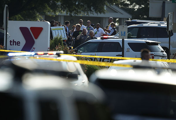 <div class='meta'><div class='origin-logo' data-origin='none'></div><span class='caption-text' data-credit='Alex Wong/Getty Images'>Investigators gather near the scene of an opened fire June 14, 2017 in Alexandria, Virginia. Multiple injuries were reported from the instance.</span></div>
