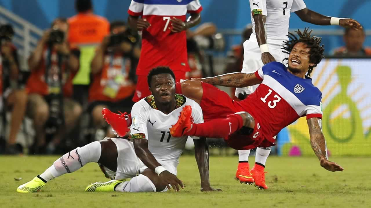 United States&#39; Jermaine Jones &#40;13&#41; falls behind Ghana&#39;s Sulley Muntari &#40;11&#41; during the group G World Cup soccer match between Ghana and the United States at the Arena das Dunas. <span class=meta>(AP Photo&#47;Julio Cortez)</span>