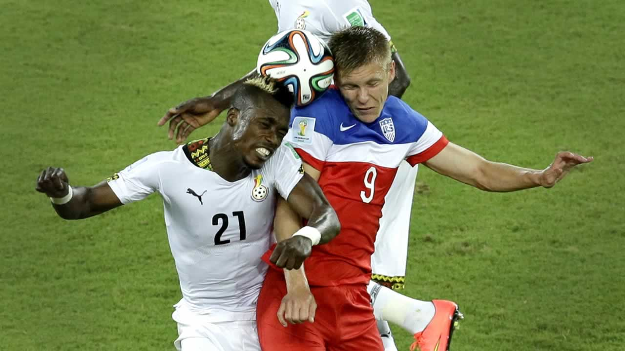 Ghana&#39;s John Boye, left, and United States&#39; Aron Johannsson go for a header during the group G World Cup soccer match between Ghana and the United States. <span class=meta>(AP Photo&#47;Hassan Ammar)</span>