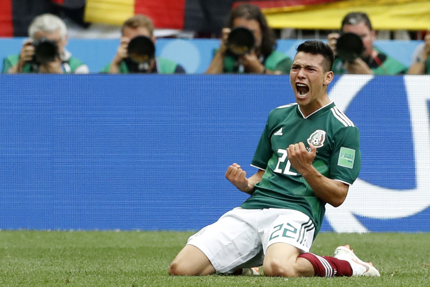 <div class='meta'><div class='origin-logo' data-origin='AP'></div><span class='caption-text' data-credit='AP Photo/Antonio Calanni'>Mexico's Hirving Lozano, celebrates scoring his side's opening goal during the group F match between Germany and Mexico at the 2018 soccer World Cup in the Luzhniki Stadium.</span></div>