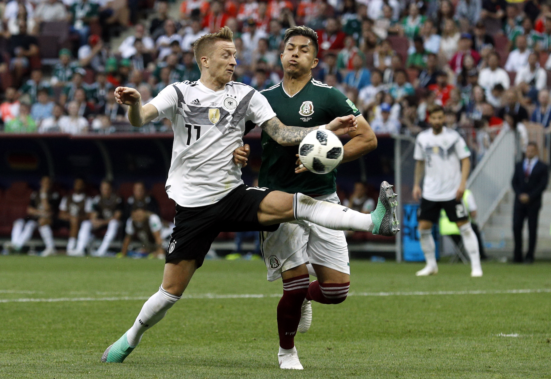 <div class='meta'><div class='origin-logo' data-origin='AP'></div><span class='caption-text' data-credit='AP Photo/Victor R. Caivano'>Germany's Marco Reus, left, fights for the ball with Mexico's Carlos Salcedo during the group F match between Germany and Mexico at the 2018 soccer World Cup.</span></div>
