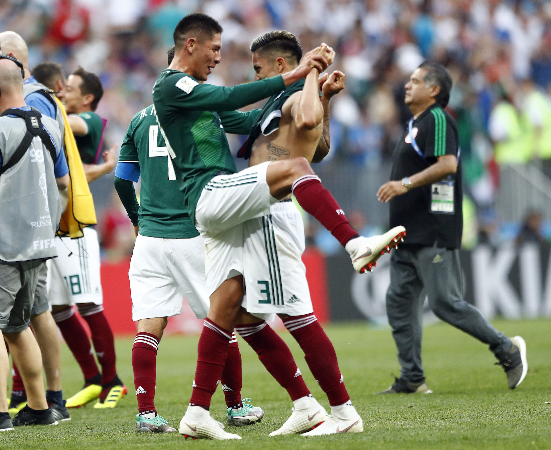 <div class='meta'><div class='origin-logo' data-origin='AP'></div><span class='caption-text' data-credit='AP Photo/Matthias Schrader'>Mexico players celebrate after winning the group F match between Germany and Mexico at the 2018 soccer World Cup in the Luzhniki Stadium in Moscow, Russia.</span></div>