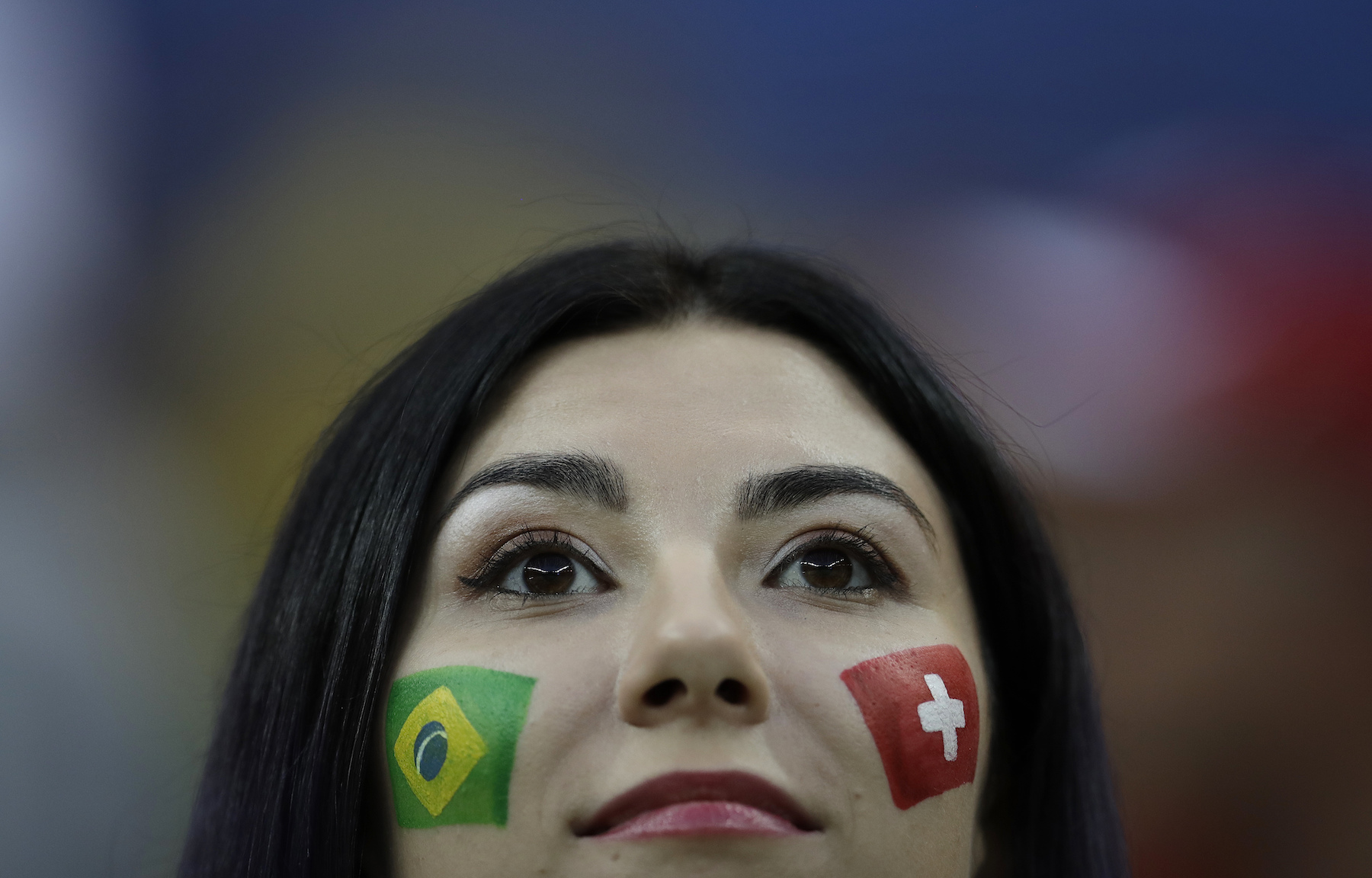 <div class='meta'><div class='origin-logo' data-origin='AP'></div><span class='caption-text' data-credit='AP Photo/Felipe Dana'>A soccer supporter show flags painted on her cheeks during the group E match between Brazil and Switzerland at the 2018 soccer World Cup in the Rostov Arena.</span></div>