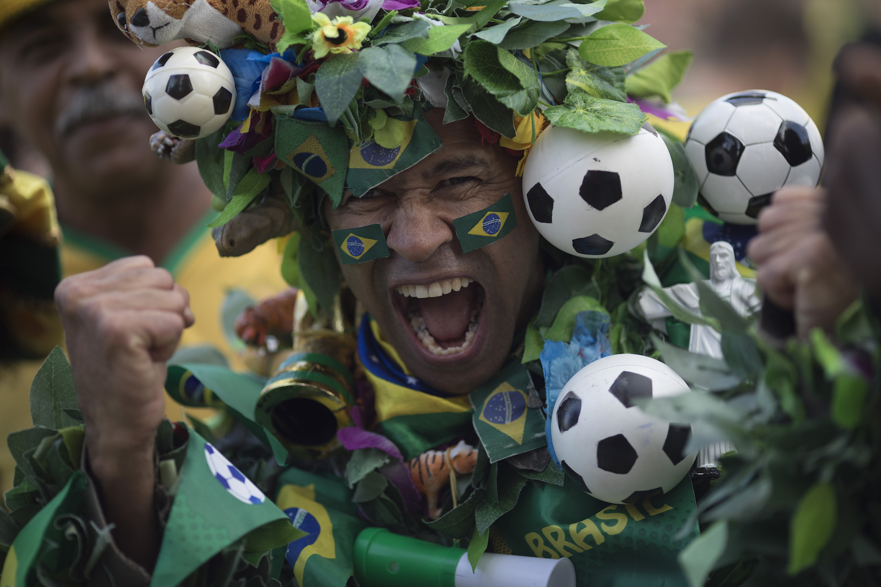 <div class='meta'><div class='origin-logo' data-origin='AP'></div><span class='caption-text' data-credit='AP Photo/Leo Correa'>A Brazil soccer fan, in a costume, poses to the camera as he cheers before his team's World Cup match against Switzerland in Rio de Janeiro, Brazil, Sunday, June 17, 2018.</span></div>