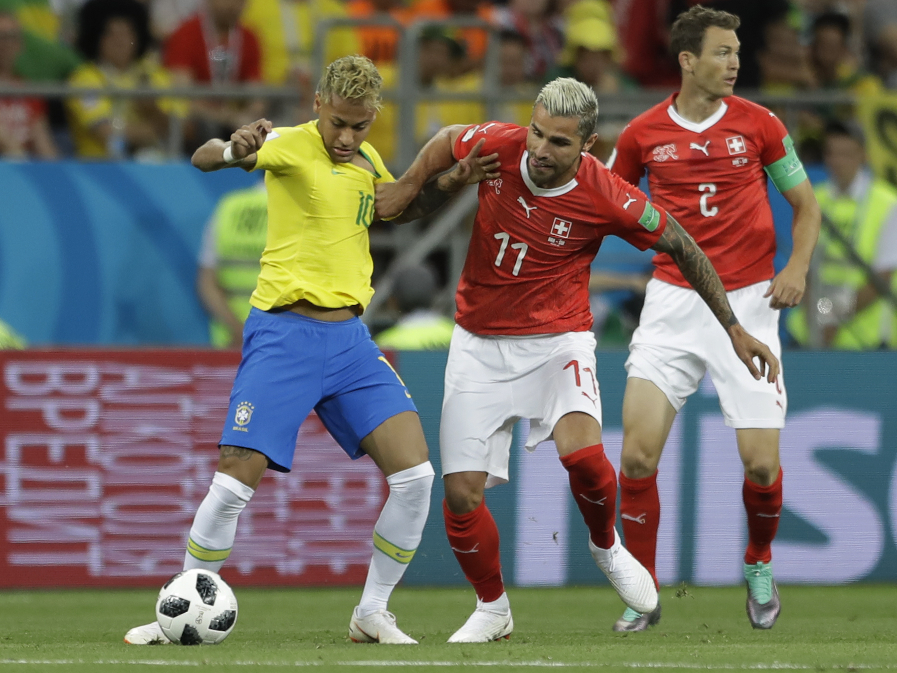 <div class='meta'><div class='origin-logo' data-origin='AP'></div><span class='caption-text' data-credit='AP Photo/Andre Penner'>Brazil's Neymar, left, is challenged for the ball by Switzerland's Valon Behrami during the group E match between Brazil and Switzerland at the 2018 soccer World Cup.</span></div>