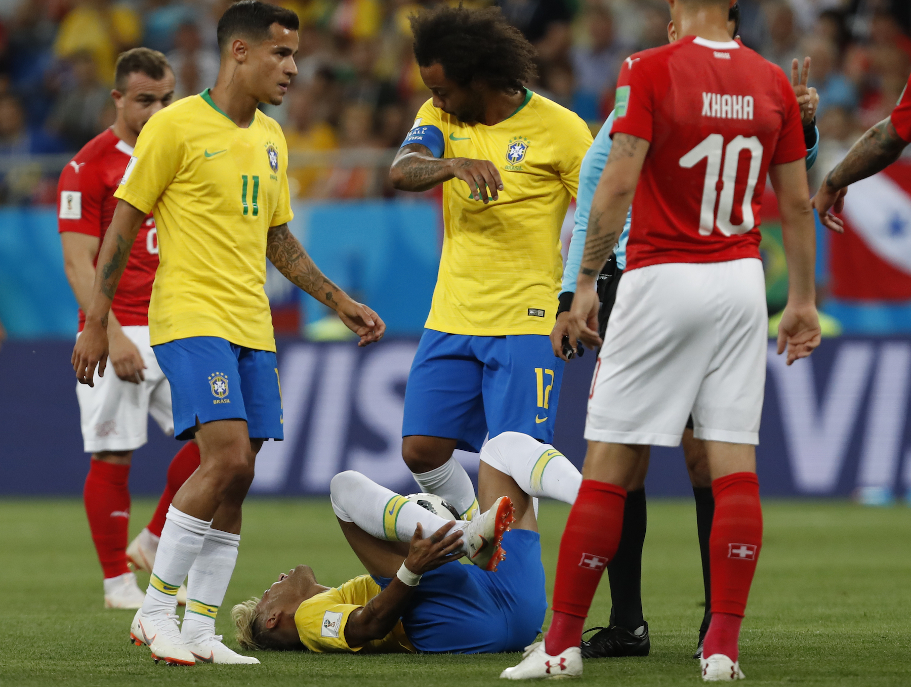 <div class='meta'><div class='origin-logo' data-origin='AP'></div><span class='caption-text' data-credit='AP Photo/Darko Vojinovic'>Brazil's Neymar lies on the ground during the group E match between Brazil and Switzerland at the 2018 soccer World Cup in the Rostov Arena in Rostov-on-Don, Russia.</span></div>