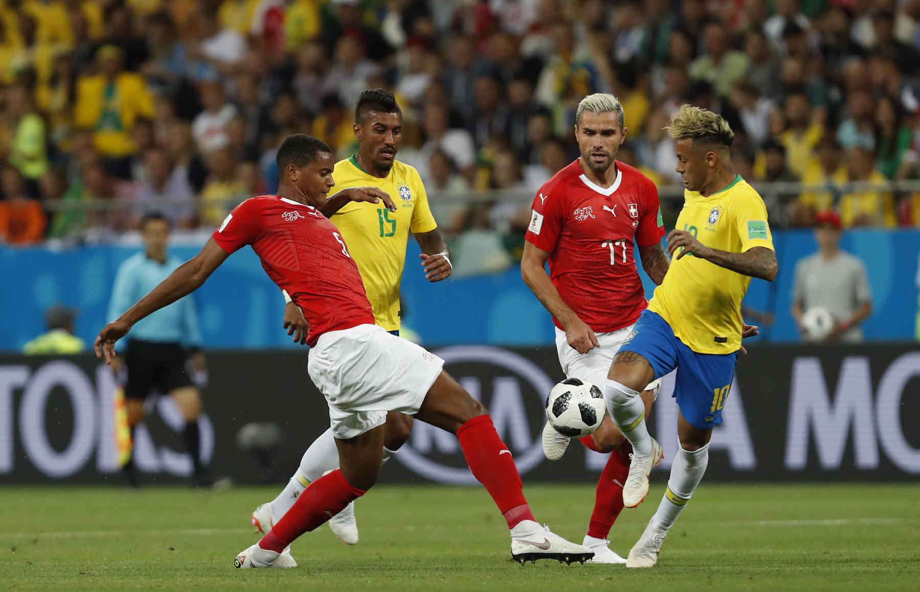 <div class='meta'><div class='origin-logo' data-origin='AP'></div><span class='caption-text' data-credit='AP Photo/Darko Vojinovic'>Brazil's Neymar, right, duels for the ball with Switzerland's Manuel Akanji during the group E match between Brazil and Switzerland at the 2018 soccer World Cup.</span></div>