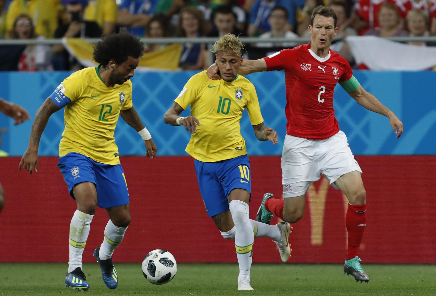 <div class='meta'><div class='origin-logo' data-origin='AP'></div><span class='caption-text' data-credit='AP Photo/Darko Vojinovic'>Brazil's Neymar, center, duels for the ball with Switzerland's Stephan Lichtsteiner, right, during the group E match between Brazil and Switzerland at the 2018 soccer World Cup.</span></div>