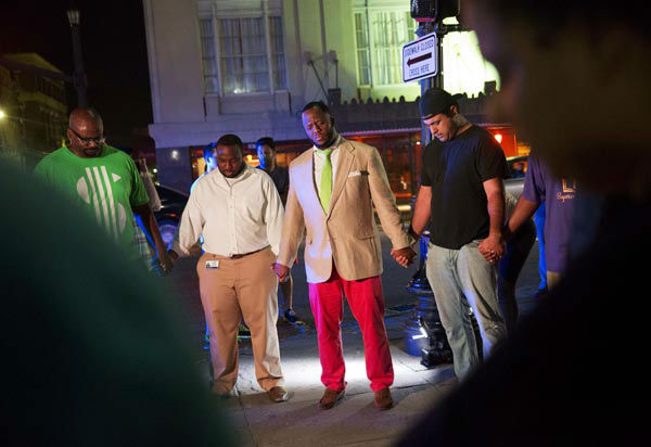 <div class='meta'><div class='origin-logo' data-origin='none'></div><span class='caption-text' data-credit='AP Photo/ David Goldman'>Worshippers gather to pray down the street from the Emanuel AME Church following a shooting Wednesday, June 17, 2015, in Charleston, S.C.</span></div>