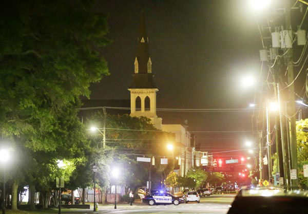 <div class='meta'><div class='origin-logo' data-origin='none'></div><span class='caption-text' data-credit='AP Photo/ David Goldman'>The steeple of Emanuel AME Church is visible as police close off a section of Calhoun Street early Thursday, June 18, 2015 following a shooting Wednesday night in Charleston, S.C.</span></div>