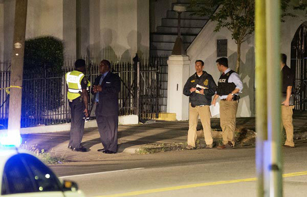 <div class='meta'><div class='origin-logo' data-origin='none'></div><span class='caption-text' data-credit='AP Photo/ David Goldman'>Police stand outside the Emanuel AME Church following a shooting Wednesday, June 17, 2015, in Charleston, S.C.</span></div>
