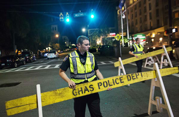 <div class='meta'><div class='origin-logo' data-origin='none'></div><span class='caption-text' data-credit='AP Photo/ David Goldman'>Police close off a section of Calhoun Street near the Emanuel AME Church following a shooting Wednesday, June 17, 2015, in Charleston, S.C.</span></div>
