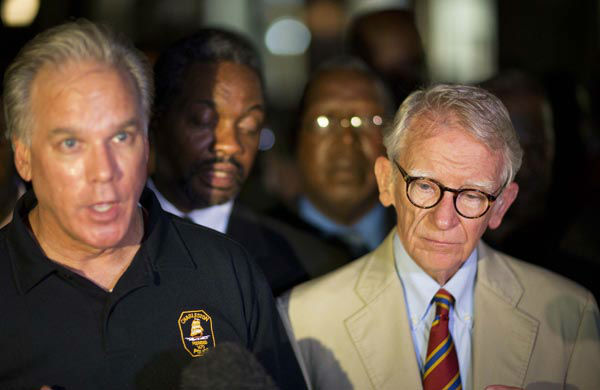 <div class='meta'><div class='origin-logo' data-origin='none'></div><span class='caption-text' data-credit='AP Photo/ David Goldman'>Charleston Mayor Joseph Riley, right, stands next to Police Chief Gregory Mullen as he addresses the media down the street from the Emanuel AME Church early Thursday, June 18, 2015</span></div>