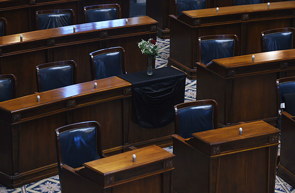 <div class='meta'><div class='origin-logo' data-origin='none'></div><span class='caption-text' data-credit='Photo/Rainier Ehrhardt'>The desk of state Sen. Clementa Pinckney, one of the nine victims in the Charleston shooting, is draped in black Thursday.</span></div>