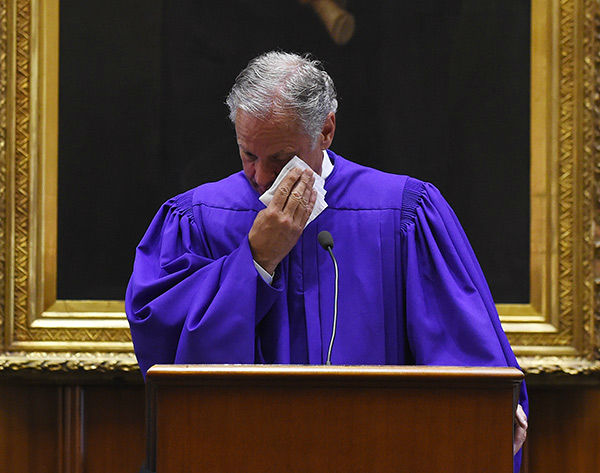 <div class='meta'><div class='origin-logo' data-origin='none'></div><span class='caption-text' data-credit='Photo/Rainier Ehrhardt'>Chaplain James St. John leads senators in prayer Thursday at the Statehouse in Columbia, S.C.</span></div>