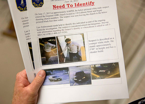<div class='meta'><div class='origin-logo' data-origin='none'></div><span class='caption-text' data-credit='AP Photo/David Goldman'>Charleston Emergency Management Director Mark Wilbert holds a flier with surveillance footage of a suspect wanted in the connection of a shooting Wednesday at Emanuel AME Church.</span></div>