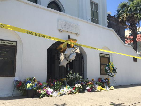 <div class='meta'><div class='origin-logo' data-origin='none'></div><span class='caption-text' data-credit='WTVD'>The growing memorial outside of Emmanuel AME Church, where the shooting occurred.</span></div>