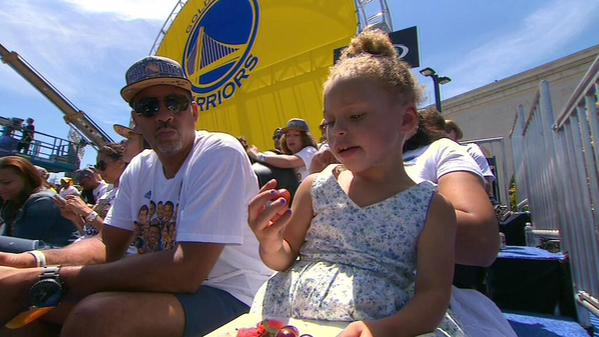 "<div class=""meta image-caption""><div class=""origin-logo origin-image none""><span>none</span></div><span class=""caption-text"">Riley Curry supports her dad Steph at the rally honoring the Golden State Warriors outside Oakland's Kaiser Convention Center on Friday, June 19, 2015. (KGO-TV)</span></div>"