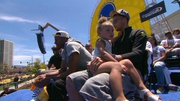 "<div class=""meta image-caption""><div class=""origin-logo origin-image none""><span>none</span></div><span class=""caption-text"">Warriors' Splash Brother Steph Curry sits with his daughter Riley at the rally honoring the NBA champions outside Oakland's Kaiser Convention Center on Friday, June 19, 2015. (KGO-TV)</span></div>"