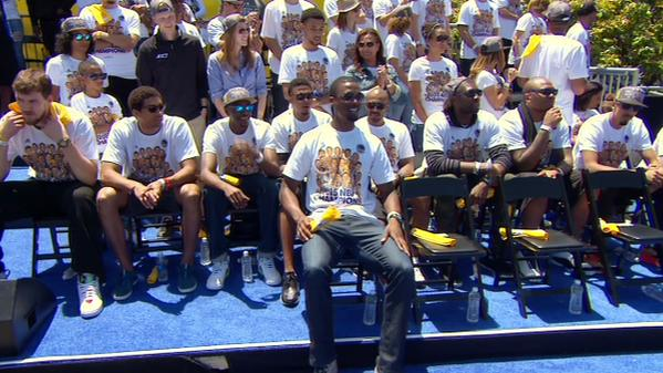 "<div class=""meta image-caption""><div class=""origin-logo origin-image none""><span>none</span></div><span class=""caption-text"">NBA champions the Golden State Warriors sit at a rally honoring the team outside Oakland's Kaiser Convention Center on Friday, June 19, 2015. (KGO-TV)</span></div>"