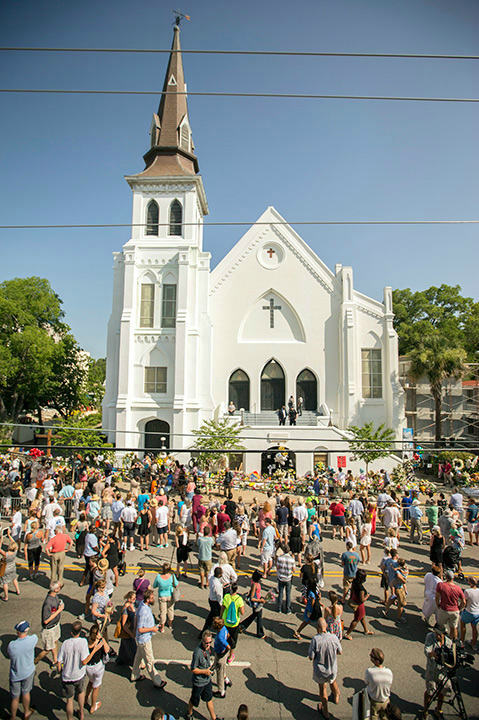 <div class='meta'><div class='origin-logo' data-origin='none'></div><span class='caption-text' data-credit='AP Photo/Stephen B. Morton'>Hundreds of people stand outside the Emanuel A.M.E. Church during a morning service four days after a mass shooting that claimed the lives of it's pastor and eight others.</span></div>