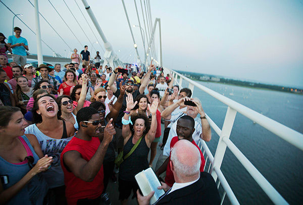 <div class='meta'><div class='origin-logo' data-origin='none'></div><span class='caption-text' data-credit='AP Photo/David Goldman'>Thousands marched on Charleston's Ravenel Bridge in a show of unity Sunday after last week's shooting at Emanuel AME Church that killed nine people.</span></div>