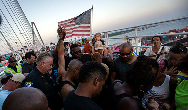 <div class='meta'><div class='origin-logo' data-origin='none'></div><span class='caption-text' data-credit='AP Photo/Stephen B. Morton'>Thousands marched on Charleston's Ravenel Bridge in a show of unity Sunday after last week's shooting at Emanuel AME Church that killed nine people.</span></div>