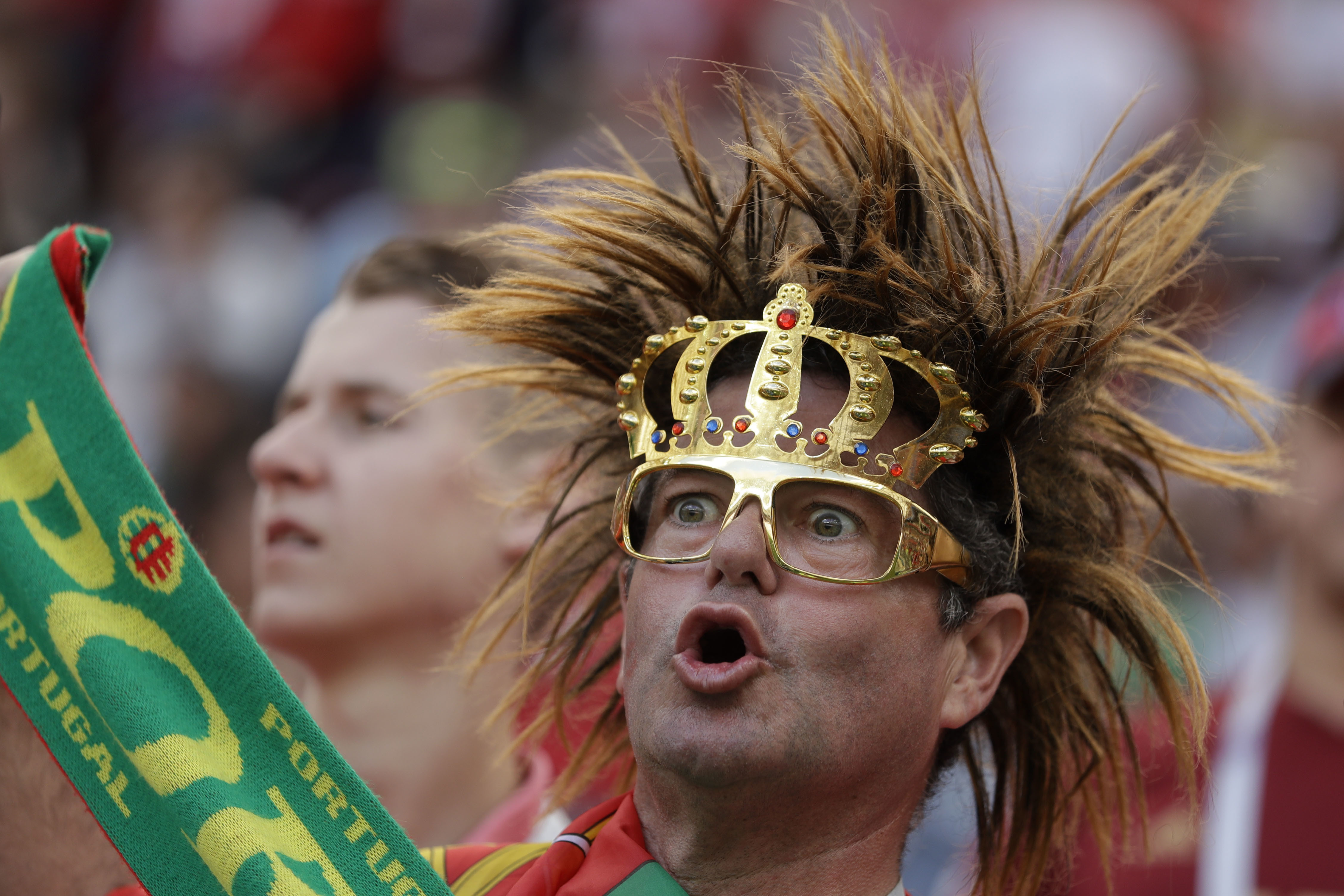 <div class='meta'><div class='origin-logo' data-origin='none'></div><span class='caption-text' data-credit='Matthias Schrader/AP Photo'>A supporter of Portugal cheers prior to the group B match between Portugal and Morocco in the Luzhniki Stadium in Moscow, Russia, Wednesday, June 20, 2018.</span></div>