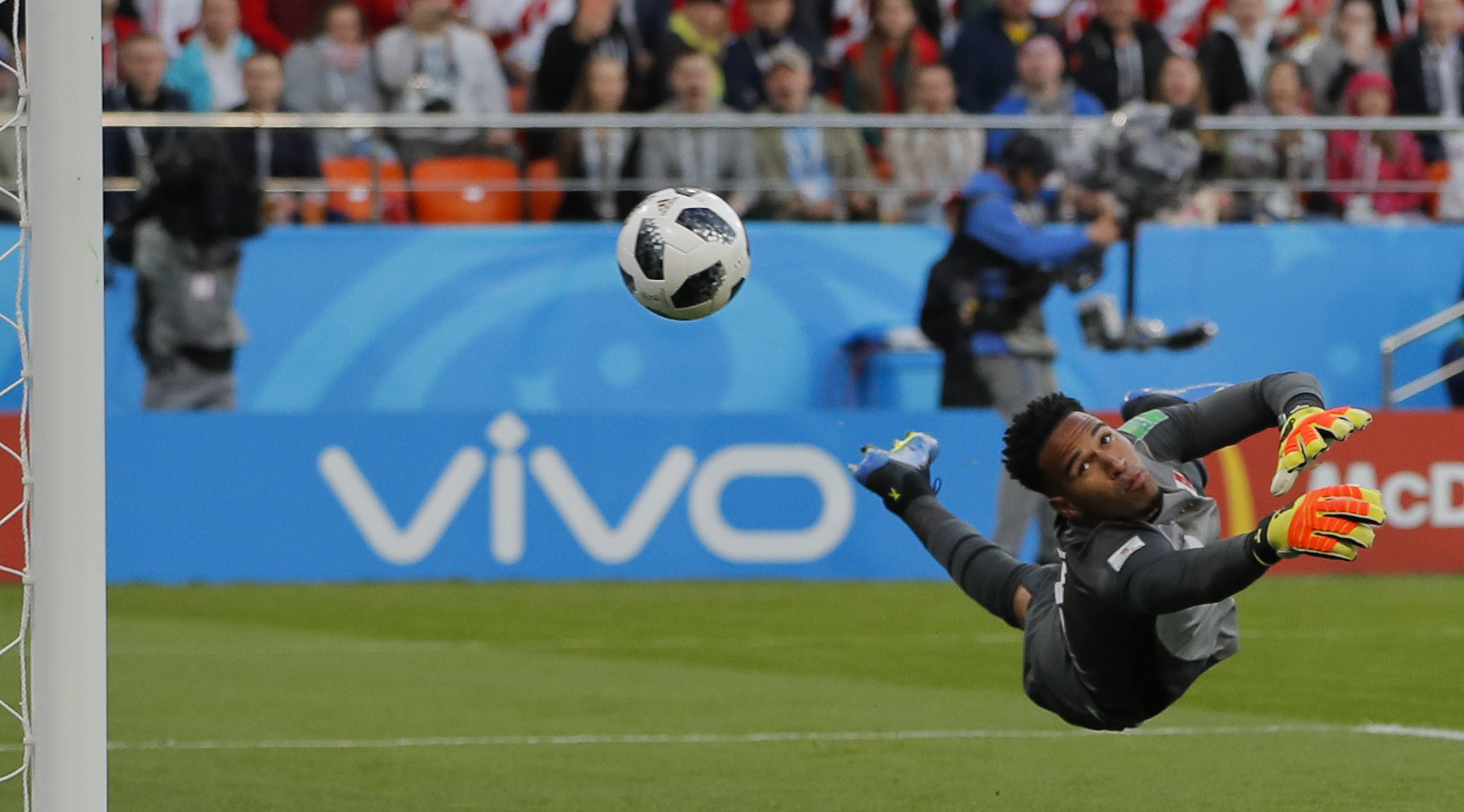 <div class='meta'><div class='origin-logo' data-origin='none'></div><span class='caption-text' data-credit='Vadim Ghirda/AP Photo'>Peru goalkeeper Pedro Gallese dives for a save during the group C match between France and Peru n the Yekaterinburg Arena in Yekaterinburg, Russia, Thursday, June 21, 2018.</span></div>