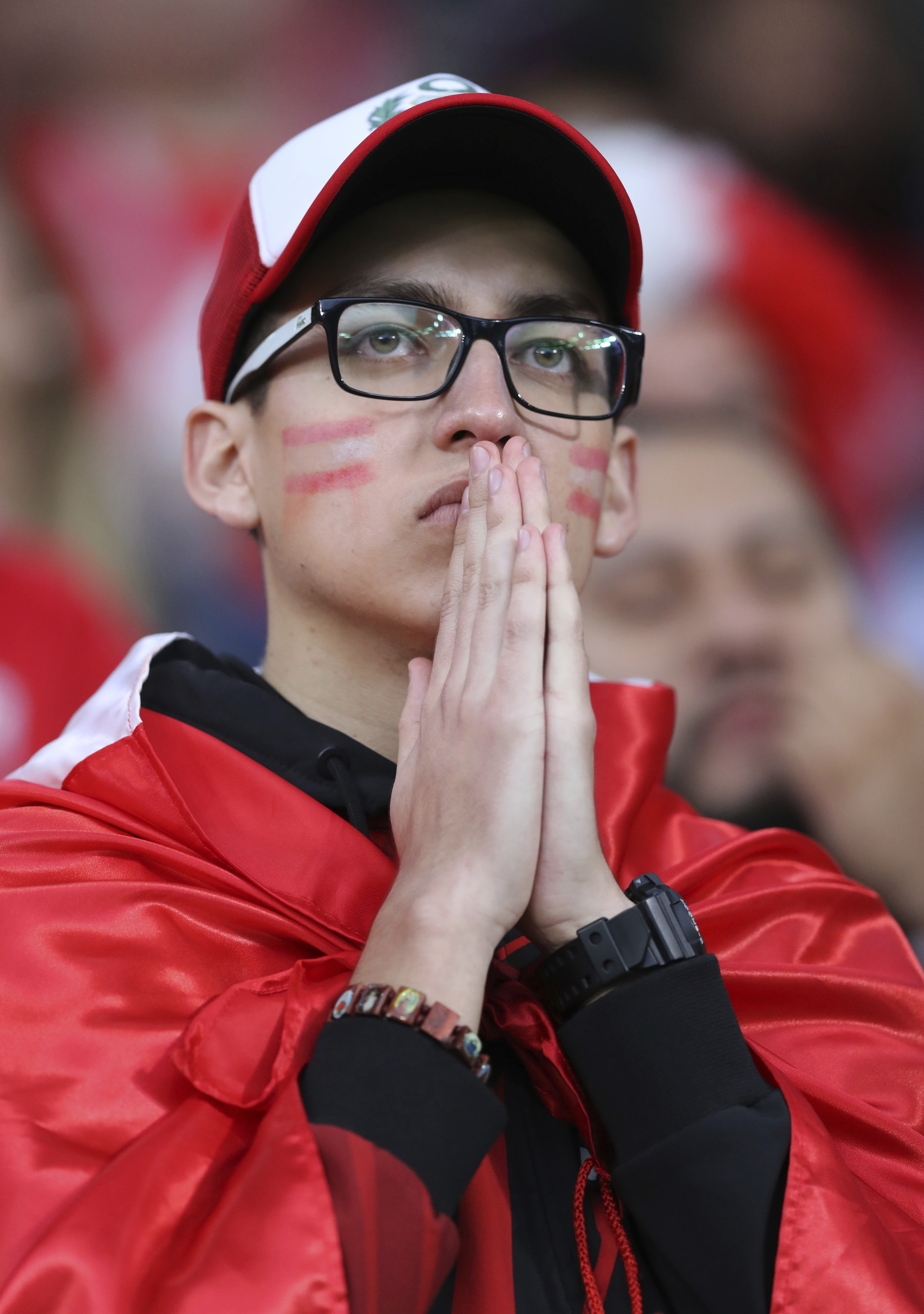 <div class='meta'><div class='origin-logo' data-origin='none'></div><span class='caption-text' data-credit='David Vincent/AP Photo'>A Peruvian fan watches the game from stands during the group C match between France and Peru  in the Yekaterinburg Arena in Yekaterinburg, Russia on June 21, 2018.</span></div>