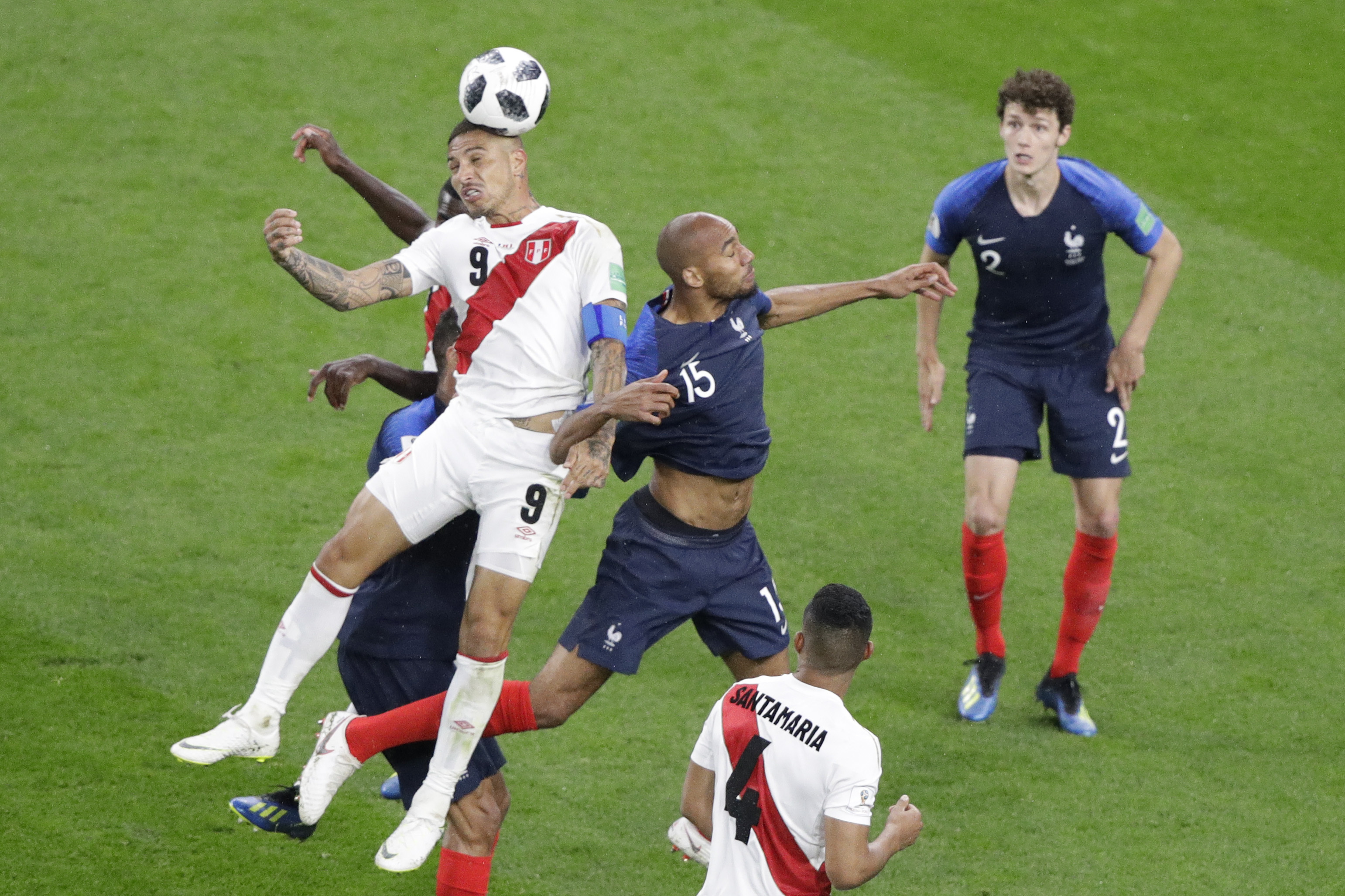 <div class='meta'><div class='origin-logo' data-origin='none'></div><span class='caption-text' data-credit='Mark Baker/AP Photo'>Peru's Paolo Guerrero, left, and France's Steven Nzonzi challenge for the ball during the group C match between France and Peru in the Yekaterinburg Arena on Thursday, June 21.</span></div>