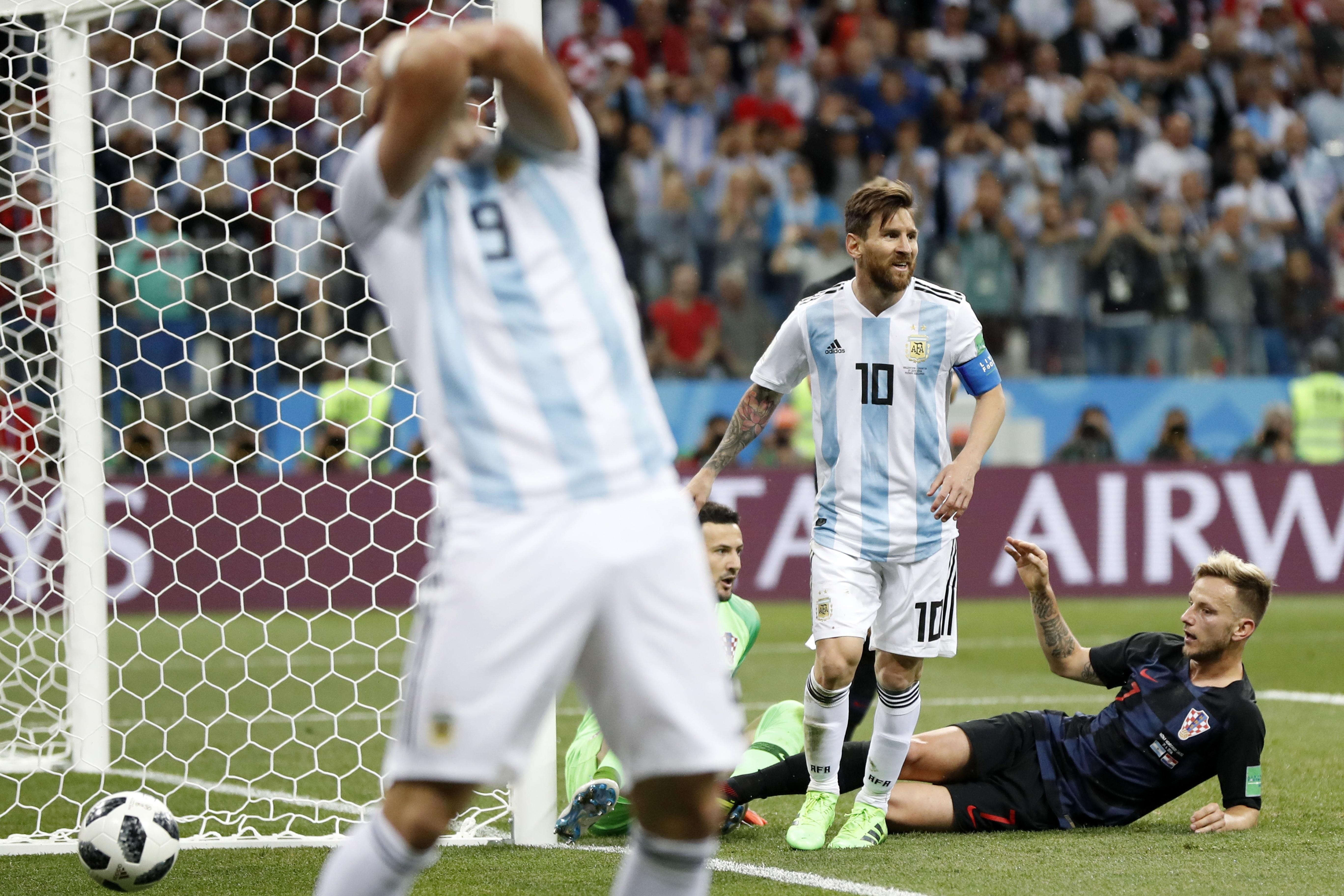 <div class='meta'><div class='origin-logo' data-origin='none'></div><span class='caption-text' data-credit='Petr David Josek/AP Photo'>Argentina's Lionel Messi, center, reacts after missing to score during the group D match between Argentina and Croatia in Nizhny Novgorod Stadium on June 21.</span></div>