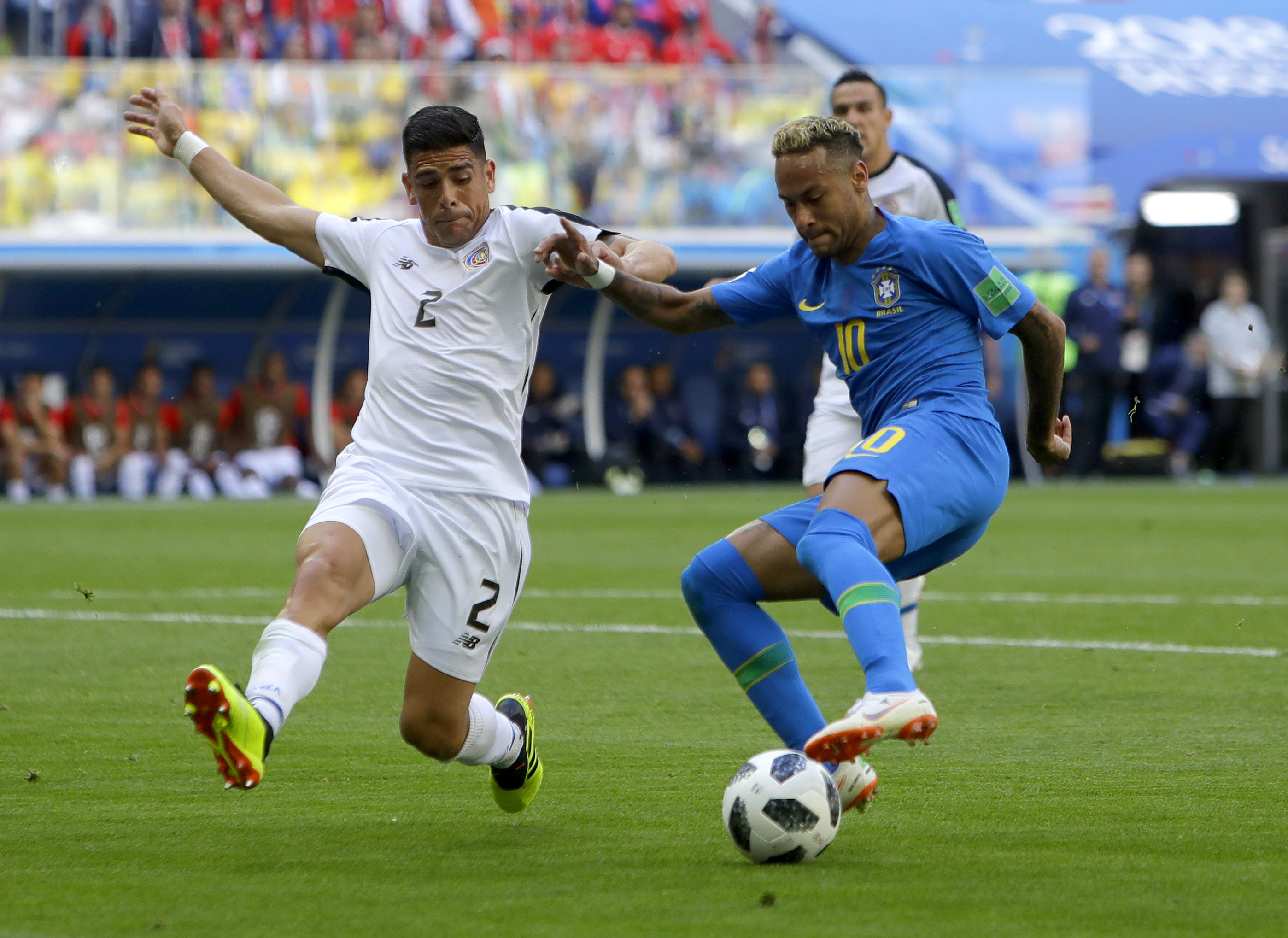 <div class='meta'><div class='origin-logo' data-origin='none'></div><span class='caption-text' data-credit='Alastair Grant/AP Photo'>Brazil's Neymar, right, looks to kick the ball past Costa Rica's Johnny Acosta during the group E match in the St. Petersburg Stadium on Friday, June 22.</span></div>