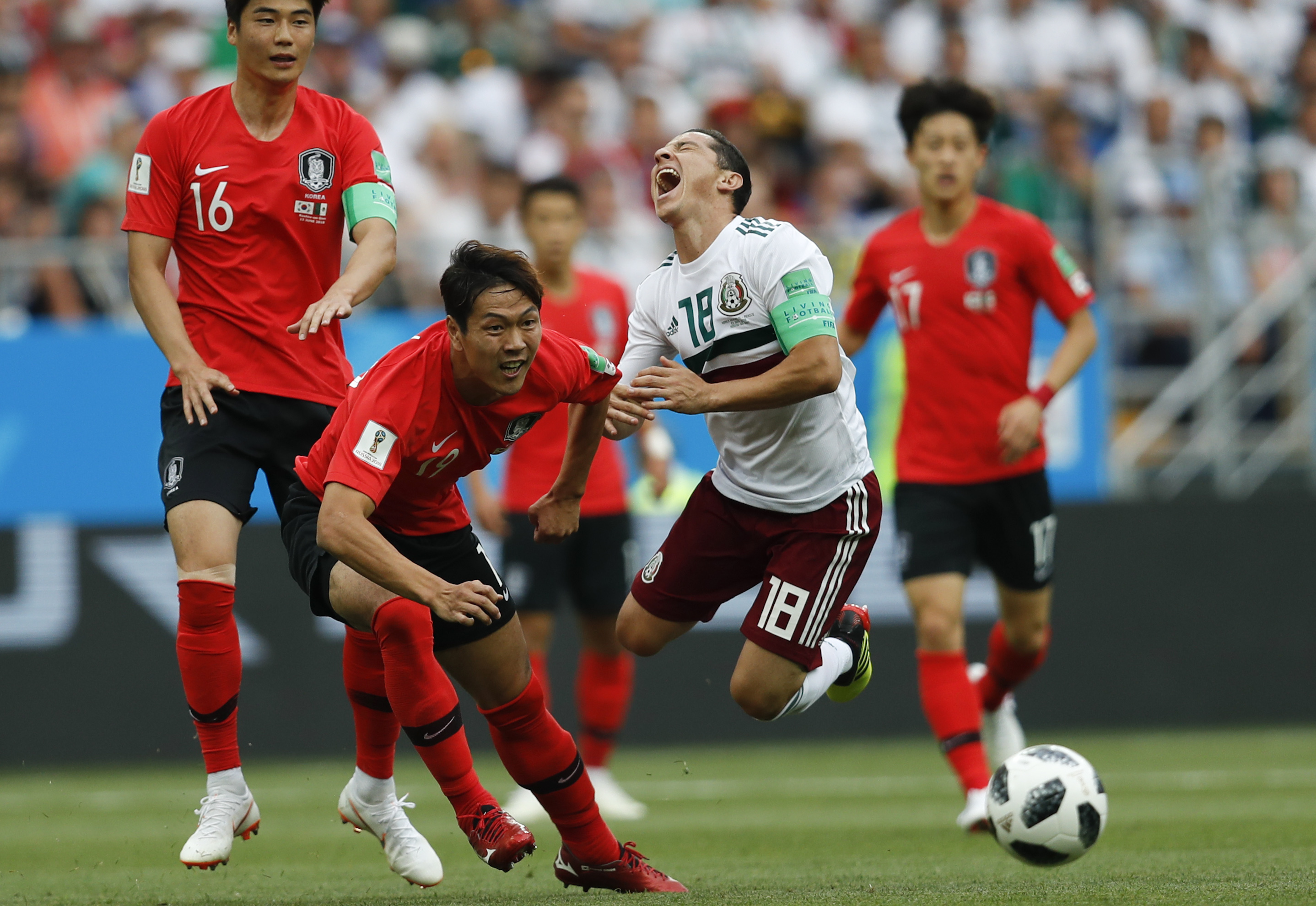 <div class='meta'><div class='origin-logo' data-origin='none'></div><span class='caption-text' data-credit='Eduardo Verdugo/AP Photo'>Mexico's Andres Guardado, right, challenges for the ball with South Korea's Kim Young-gwon during the group F match in the Rostov Arena on June 23.</span></div>