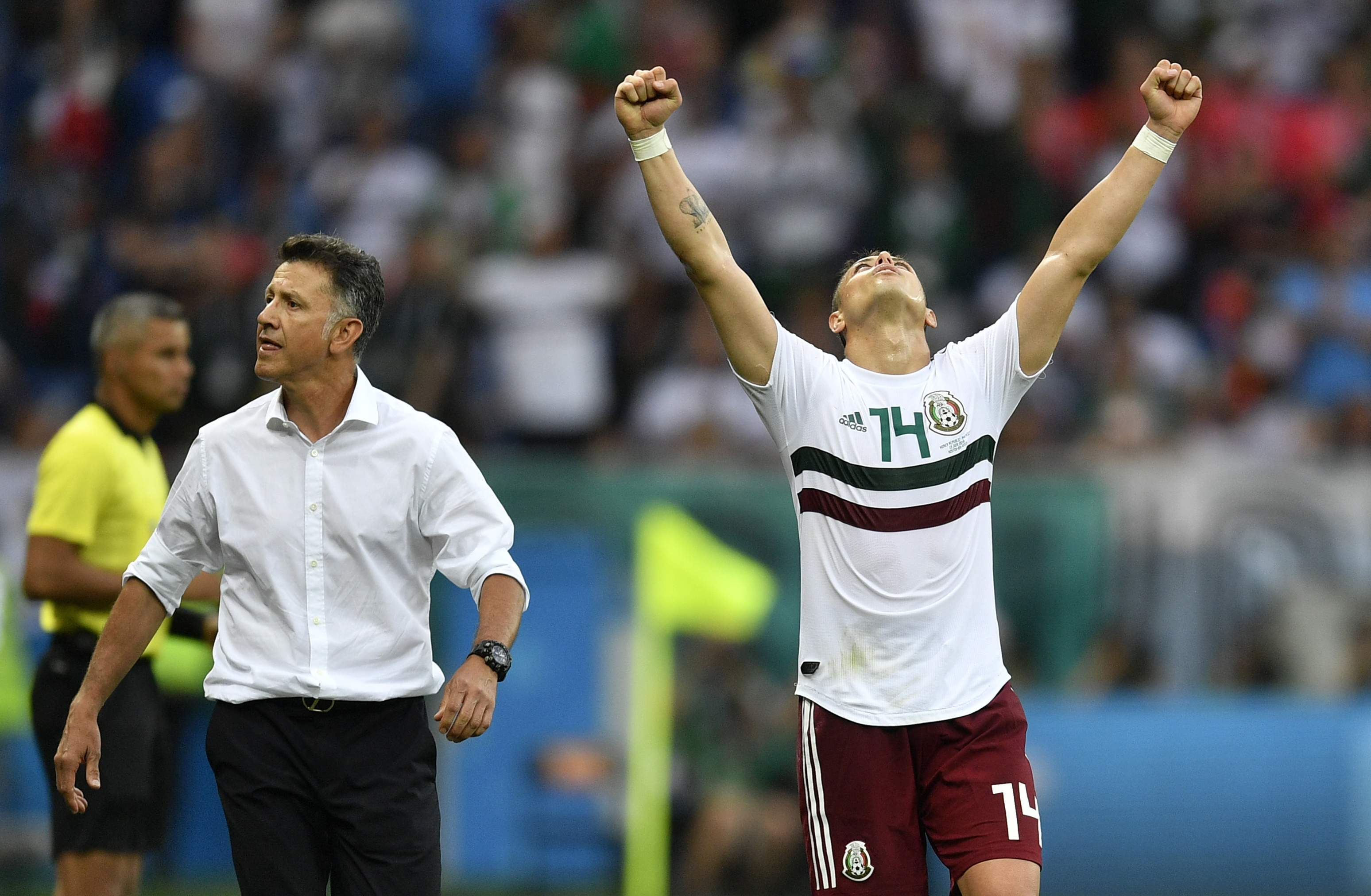<div class='meta'><div class='origin-logo' data-origin='none'></div><span class='caption-text' data-credit='Martin Meissner/AP Photo'>Mexico's Javier Hernandez celebrates beside Mexico head coach Juan Carlos Osorio at the end of the group F match between Mexico and South Korea in the Rostov Arena on June 23.</span></div>