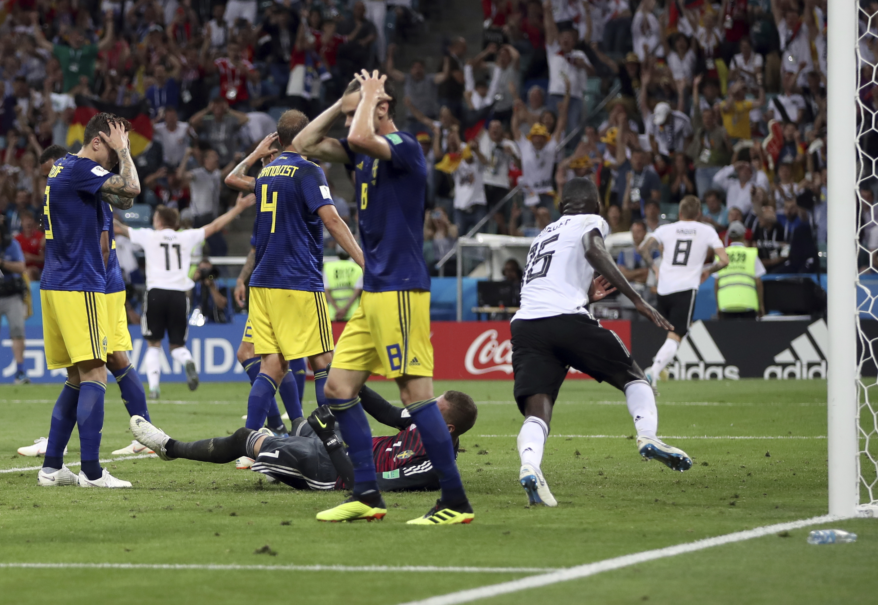 <div class='meta'><div class='origin-logo' data-origin='none'></div><span class='caption-text' data-credit='Thanassis Stavrakis/AP Photo'>Sweden players react after Germany's Toni Kroos, right, scores his side's second goal during the group F match in the Fisht Stadium in Sochi, Russia, Saturday, June 23, 2018.</span></div>
