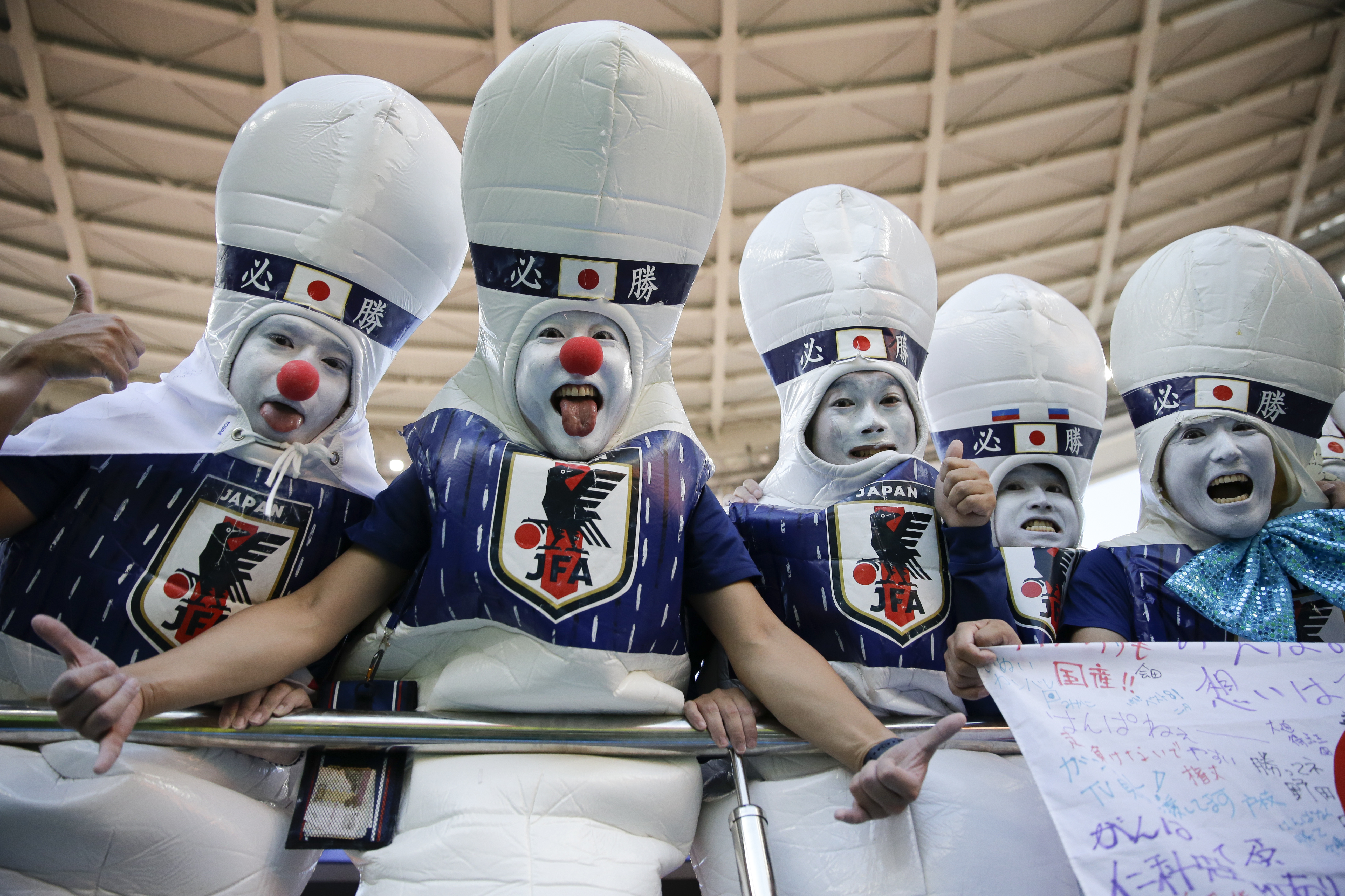 <div class='meta'><div class='origin-logo' data-origin='none'></div><span class='caption-text' data-credit='Natacha Pisarenko/AP Photo'>Japan fans support their team prior to the start of the group H match between Japan and Senegal at the Yekaterinburg Arena in Yekaterinburg, Russia, Sunday, June 24, 2018.</span></div>