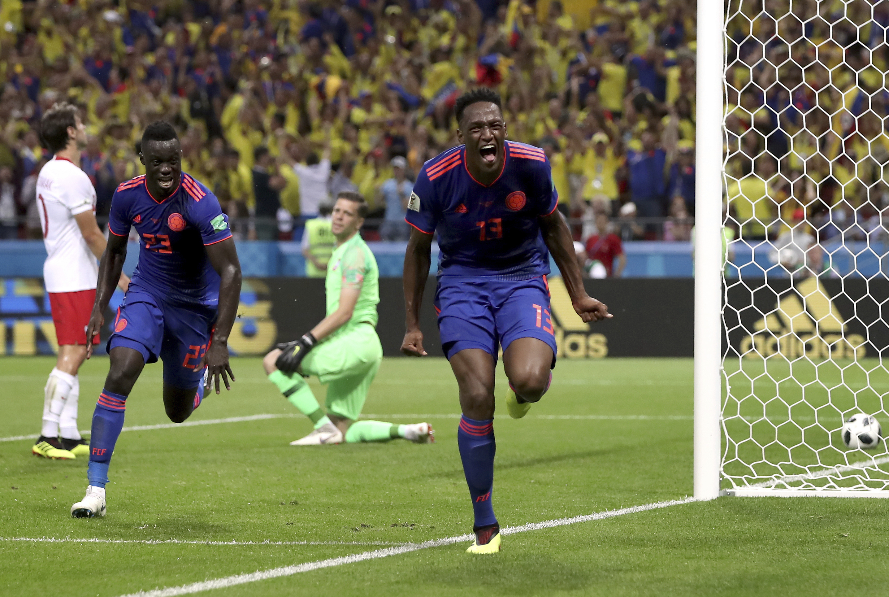 <div class='meta'><div class='origin-logo' data-origin='none'></div><span class='caption-text' data-credit='Thanassis Stavrakis/AP Photo'>Colombia's scorer Yerry Mina, right and his teammate Davinson Sanchez, left, celebrate the opening goal during the group H match against Poland at the Kazan Arena on June 24.</span></div>