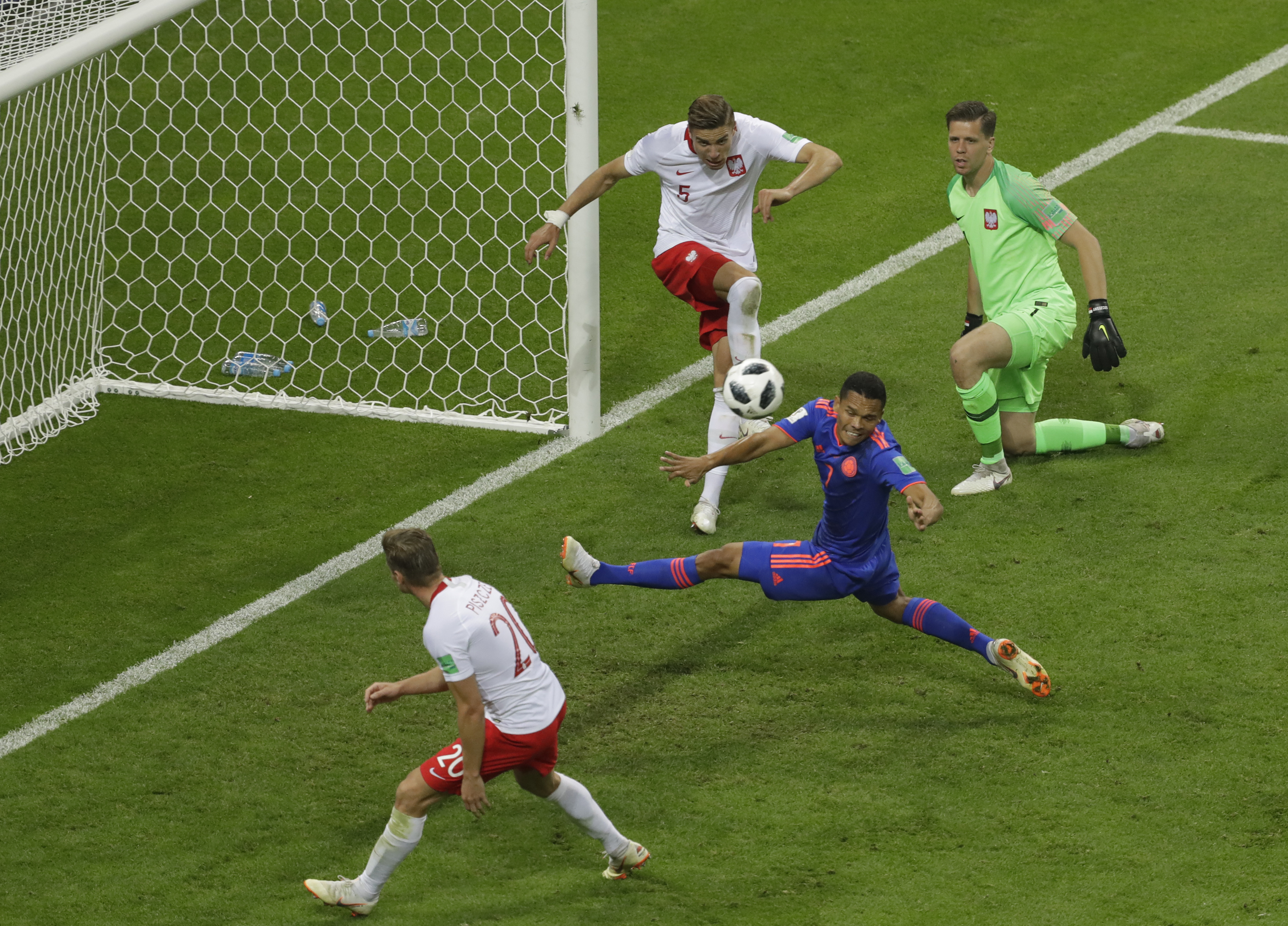 <div class='meta'><div class='origin-logo' data-origin='none'></div><span class='caption-text' data-credit='Sergei Grits/AP Photo'>Colombia's Carlos Bacca, center, tries unsuccessfully to score during the group H match between Poland and Colombia at the Kazan Arena in Kazan, Russia, Sunday, June 24, 2018.</span></div>