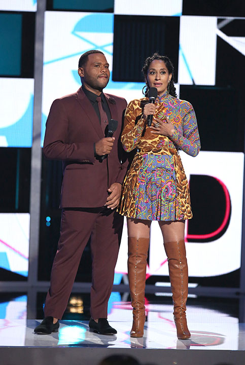 "<div class=""meta image-caption""><div class=""origin-logo origin-image none""><span>none</span></div><span class=""caption-text"">Hosts Anthony Anderson, left, and Tracee Ellis Ross speak at the BET Awards on Sunday in Los Angeles. (Matt Sayles/Invision/AP)</span></div>"