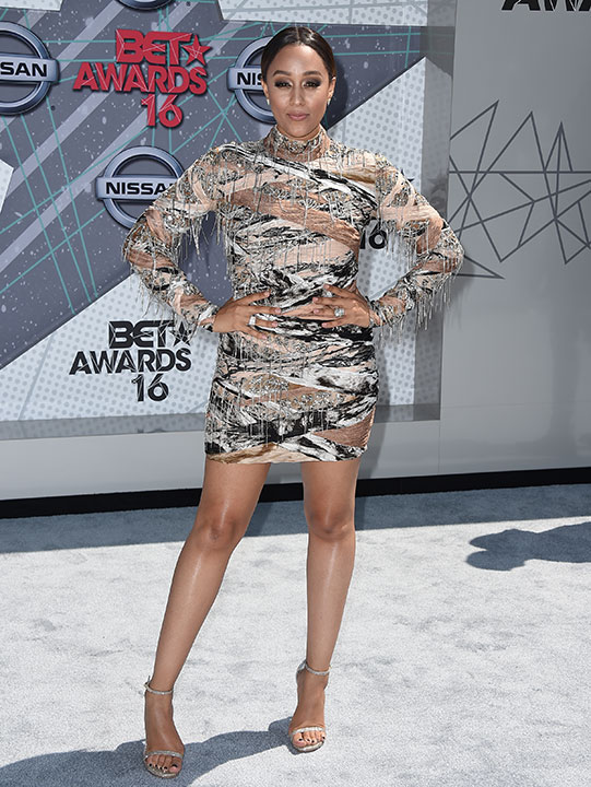 "<div class=""meta image-caption""><div class=""origin-logo origin-image none""><span>none</span></div><span class=""caption-text"">Tia Mowry arrives at the BET Awards on Sunday in Los Angeles. (Jordan Strauss/Invision/AP)</span></div>"