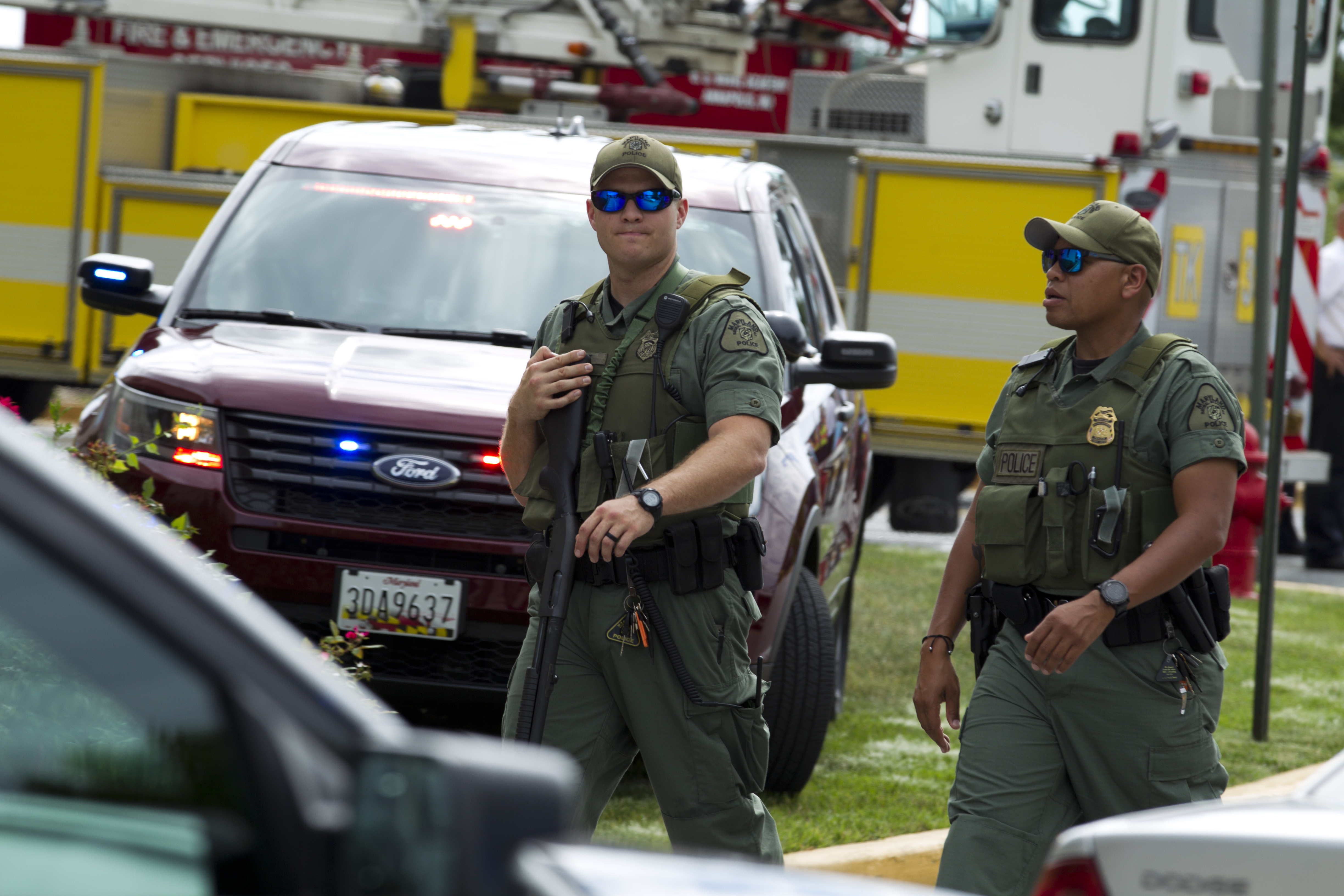<div class='meta'><div class='origin-logo' data-origin='AP'></div><span class='caption-text' data-credit='AP Photo/Jose Luis Magana'>Maryland police officers patrol the area after multiple people were shot at at The Capital Gazette newspaper in Annapolis, Md., Thursday, June 28, 2018.</span></div>