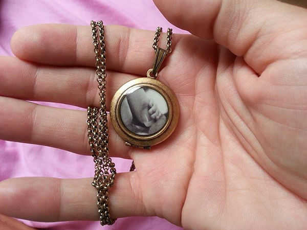 <div class='meta'><div class='origin-logo' data-origin='none'></div><span class='caption-text' data-credit='Photo/Courtesy of Kim Spratt'>Kim and Fred have a locket with Hudson's photo. They are waiting to have his memorial service until they return.</span></div>