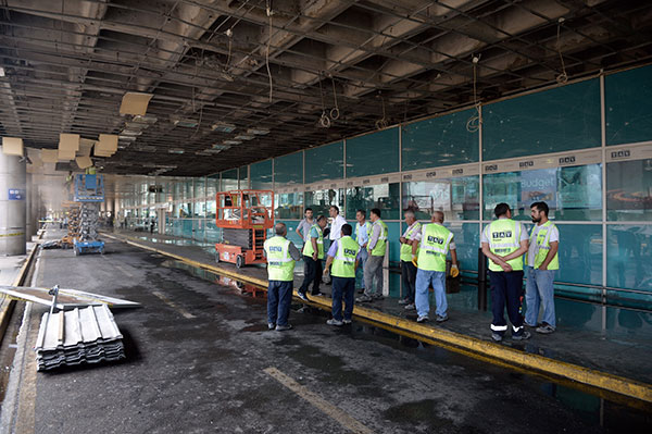 <div class='meta'><div class='origin-logo' data-origin='none'></div><span class='caption-text' data-credit='AP Photo'>Workers inspect damages at the entrance of Istanbul's Ataturk airport, Wednesday, June 29, 2016.</span></div>