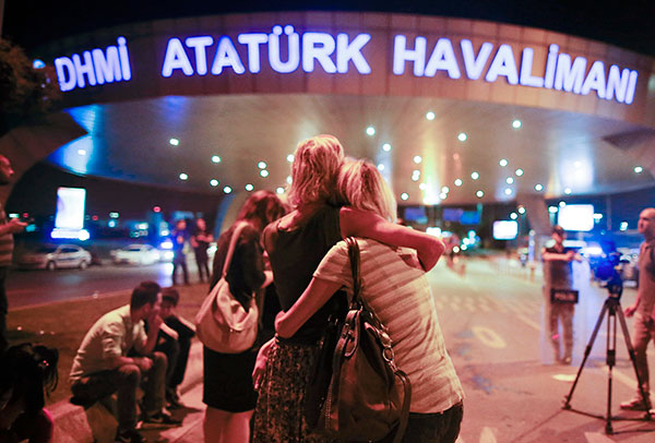"<div class=""meta image-caption""><div class=""origin-logo origin-image none""><span>none</span></div><span class=""caption-text"">Passengers embrace each other at the entrance to Istanbul's Ataturk airport, early Wednesday, June 29, 2016 following their evacuation after a blast. (Emrah Gurel/AP Photo)</span></div>"