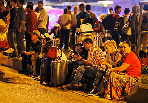 "<div class=""meta image-caption""><div class=""origin-logo origin-image none""><span>none</span></div><span class=""caption-text"">People gather outside Istanbul's Ataturk airport, early Wednesday, June 29, 2016 following its evacuation after a blast. (Emrah Gurel/AP Photo)</span></div>"